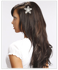 Model with long dark hair and a hair pin